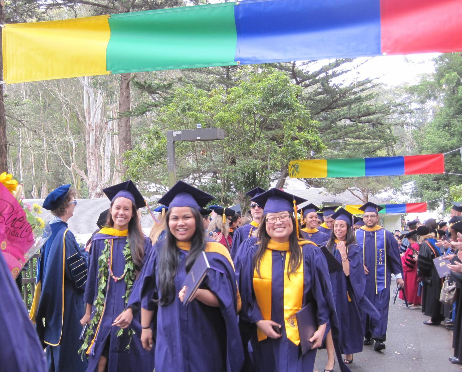 Cohort 3 graduates on the exit walkway after 2014 Commencement
