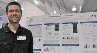 PSM cohort 3 student Kris Plamback in front of his poster in May 2014