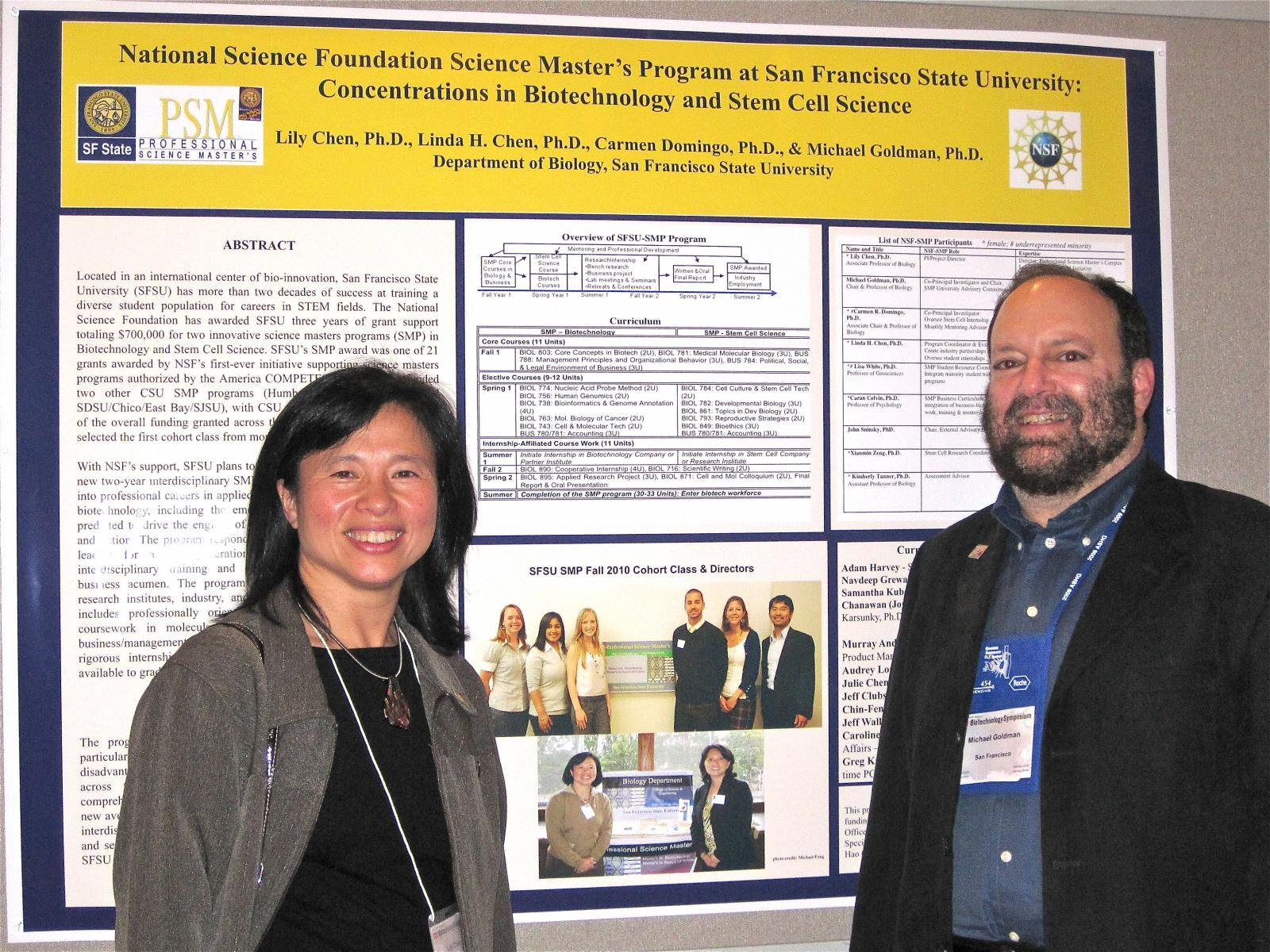 Dr. Lily Chen and Dr. Michael Goldman in front of a program poster